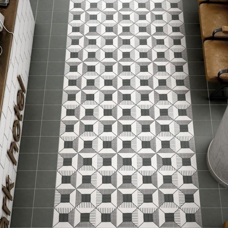 sol-carrelagecaprice-deco-block-noir-blanc-20x20-cm-formant-tapis-avec-carreau-uni