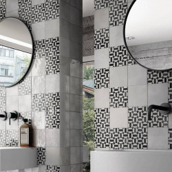 carrelage-effet-zellige-decor-graphique-artisan-lunas-noir-et-blanc-au-mur-derriere-un-miroir-de-salle-de-bains